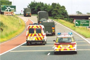 Convoy leaving motorway