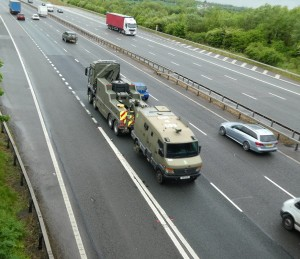 Convoy escort vehicle being towed on M40 reduced